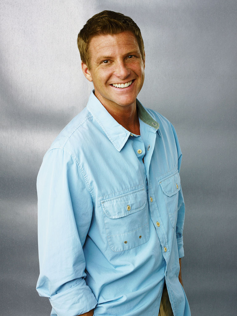 Doug Savant stars as Tom Scavo in Desperate Housewives.