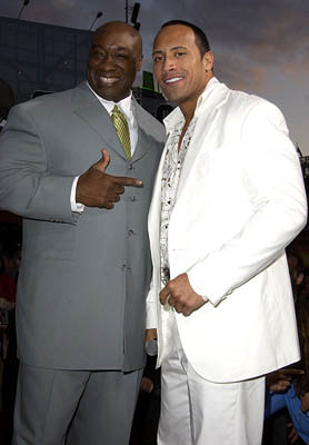 Premiere: Michael Clarke Duncan gives The Rock directions to the Smackdown Hotel at the LA premiere of Universal's The Scorpion King - 4/17/2002 Dwayne Johnson