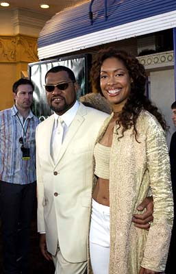 Premiere: Laurence Fishburne and Gina Torres walk in front of a Kevin Costner-lookin' guy at the Hollywood premiere of Warner Brothers' The Matrix: Reloaded - 5/7/2003