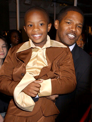 Premiere: Jamie Foxx and C.J. Sanders at the Hollywood premiere of Universal Pictures' Ray - 10/19/2004