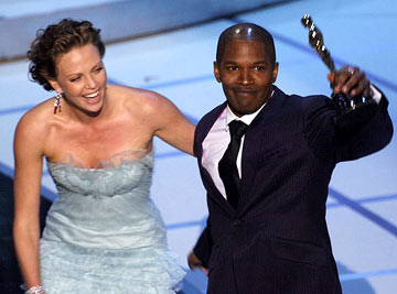 Presenter Charlize Theron and Jamie Foxx, Winner - Best Actor 77th Annual Academy Awards Ceremony Hollywood, CA - 2/27/05
