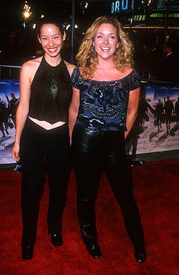 Premiere: Lucy Liu and Jane Krakowski at the Mann Village Theater premiere of Warner Brothers' Three Kings - 9/27/1999