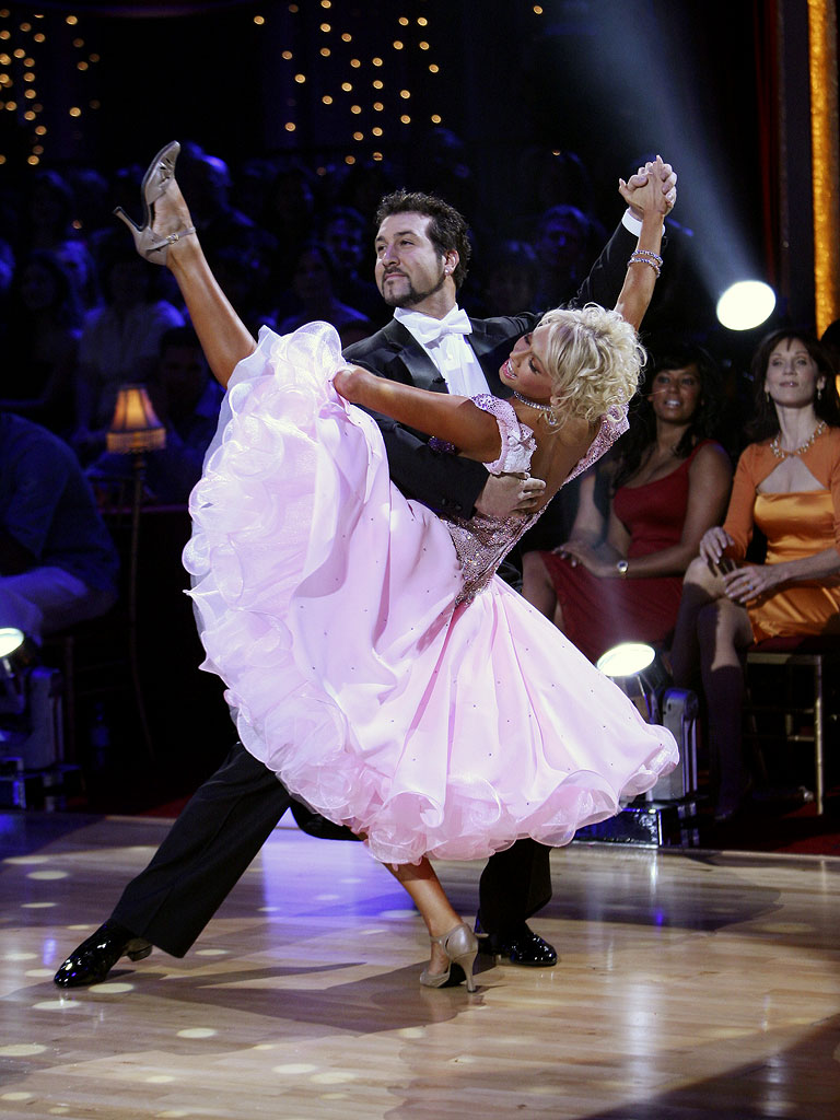 Professional dancer, Kim Johnson and Joey Fatone perform a Ballroom dance in the 4th season of Dancing with the Stars.