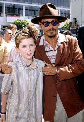 Premiere: Freddie Highmore and Johnny Depp at the LA premiere of Warner Bros. Pictures' Charlie and the Chocolate Factory - 7/10/2005