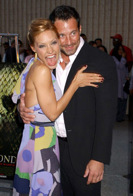 Premiere: Kadee Strickland and Johnny Messner at the Westwood premiere of Screen Gems' Anacondas: The Hunt for the Blood Orchid - 8/25/2004 Photos: Gregg DeGuire, WireImage.com