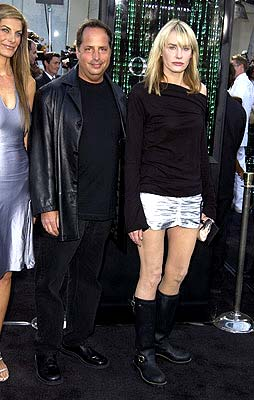 Premiere: Jon Lovitz inches closer to Daryl Hannah so he can show the pictures and say he knows her at the Hollywood premiere of Warner Brothers' The Matrix: Reloaded - 5/7/2003