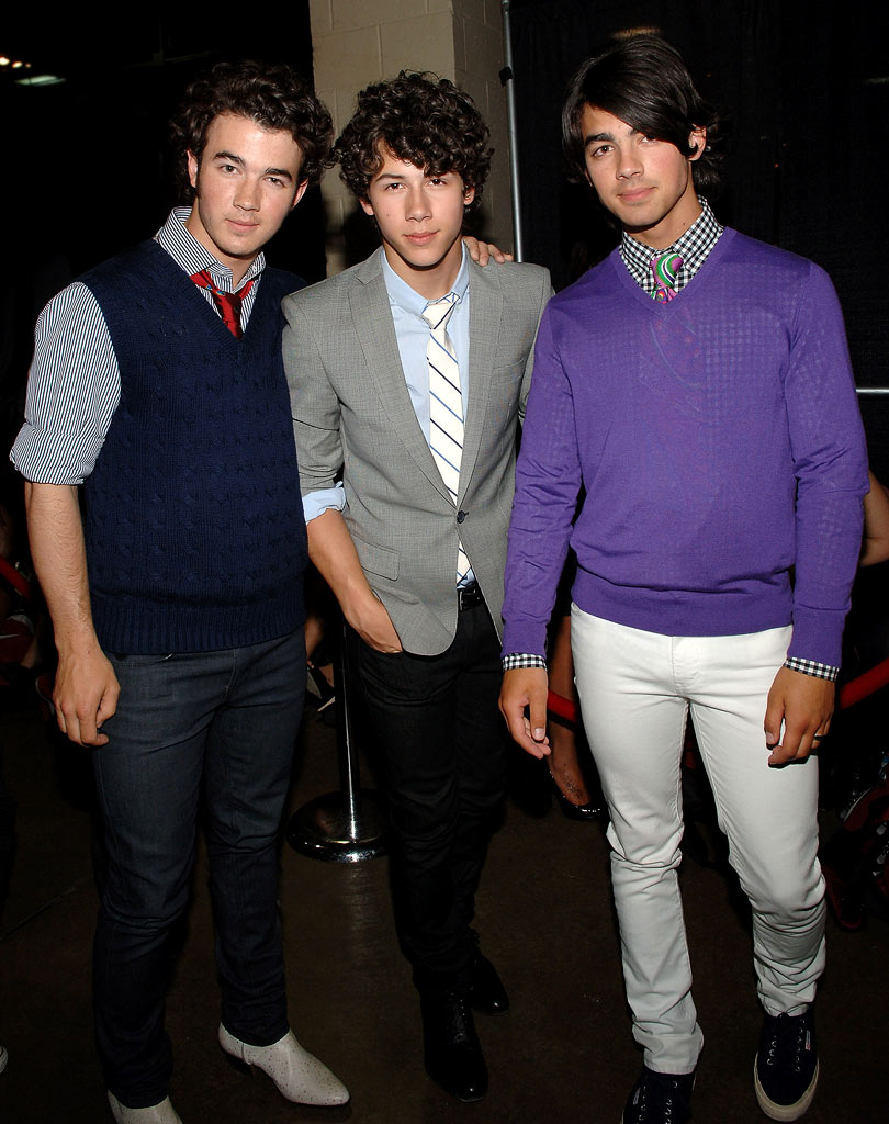 Kevin, Nick, and Joe Jonas of the Jonas Brothers pose backstage during Z100's Zootopia at the IZOD Center on May 17, 2008 in East Rutherford, New Jersey.