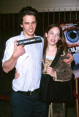 "Premiere: James Franco holds up his copy of ""Crack In America"" while Marla Sokoloff assures people that James only PLAYED a freak on ""Freaks and Geeks"" at the Egyptian Theatre premiere of Artisan's Requiem For A Dream - 10/16/2000"