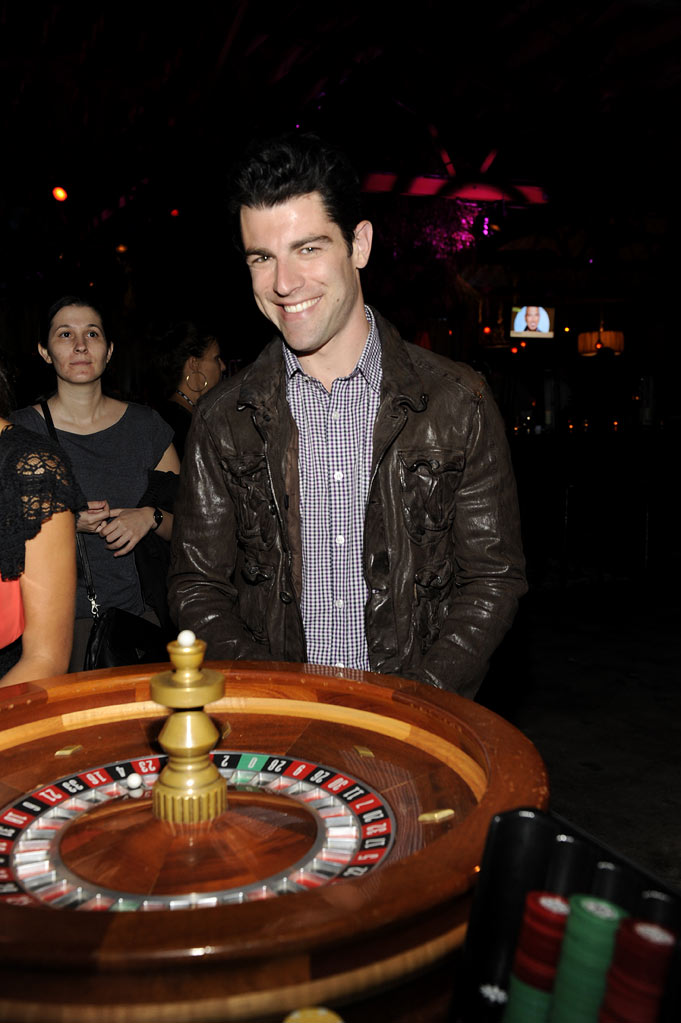 "Max Greenfield of ""New Girl"" tries his luck for charity at the 2011 Fox Fall Eco-Casino Party at The BookBindery on September 12, 2011 in Culver City, California."
