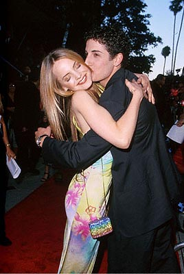 Premiere: Mena Suvari and Jason Biggs get cozy at the AVCO Theater premiere of Columbia's Loser - 7/20/2000