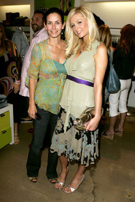 Premiere: Courteney Cox-Arquette and Paris Hilton at Kitson in Beverly Hills for Warner Bros. Pictures' House of Wax - 4/21/2005