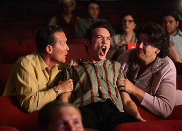 "Elvis (Jonathan Rhys-Meyers) and his parents Vernon (Robert Patrick) and Gladys (Camryn Manheim) react to the news that Elvis' song has been played on the radio ""Elvis"" - 2005"