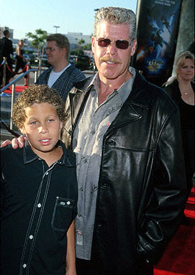 Premiere: Ron Perlman and his youngster at the Los Angeles Staples Center premiere of 20th Century Fox's Titan A.E. - 6/13/2000