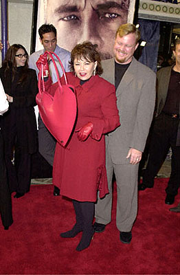 Premiere: Roseanne doesn't seem pleased to be valentined out for her man at the Westwood premiere of 20th Century Fox's Cast Away - 12/7/2000