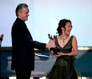 Tim Robbins with Sandra Oh of Sideways Outstanding Ensemble in a Motion Picture Screen Actors Guild Awards - 2/5/2005