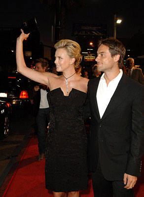 Premiere: Charlize Theron and Stuart Townsend at the LA premiere of Warner Bros. Pictures' North Country - 10/10/2005