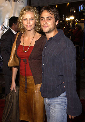 Premiere: 2 Days In the Valley star Charlize Theron and Stuart Townsend at the Westwood premiere of K-Pax - 10/22/2001