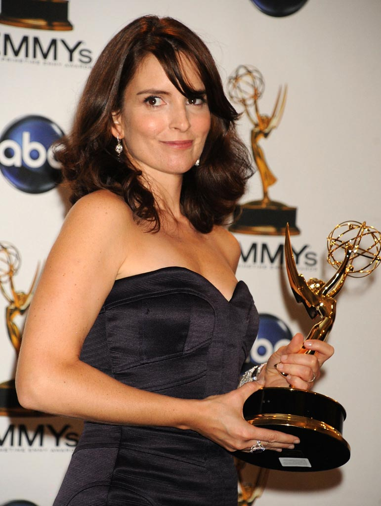 "Tina Fey poses with her Emmy for Lead Actress in a Comedy Series for ""30 Rock"" backstage at the Nokia Theatre. Tina Fey"