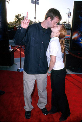 Premiere: Tom Green pauses a moment to lay a big ol' smooch on Drew Barrymore at the Los Angeles Staples Center premiere of 20th Century Fox's Titan A.E. - 6/13/2000