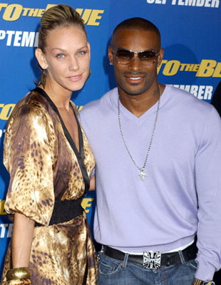 Premiere: Tyson Beckford with April Roomet at the Westwood premiere of MGM/Columbia Pictures' Into the Blue - 9/21/2005