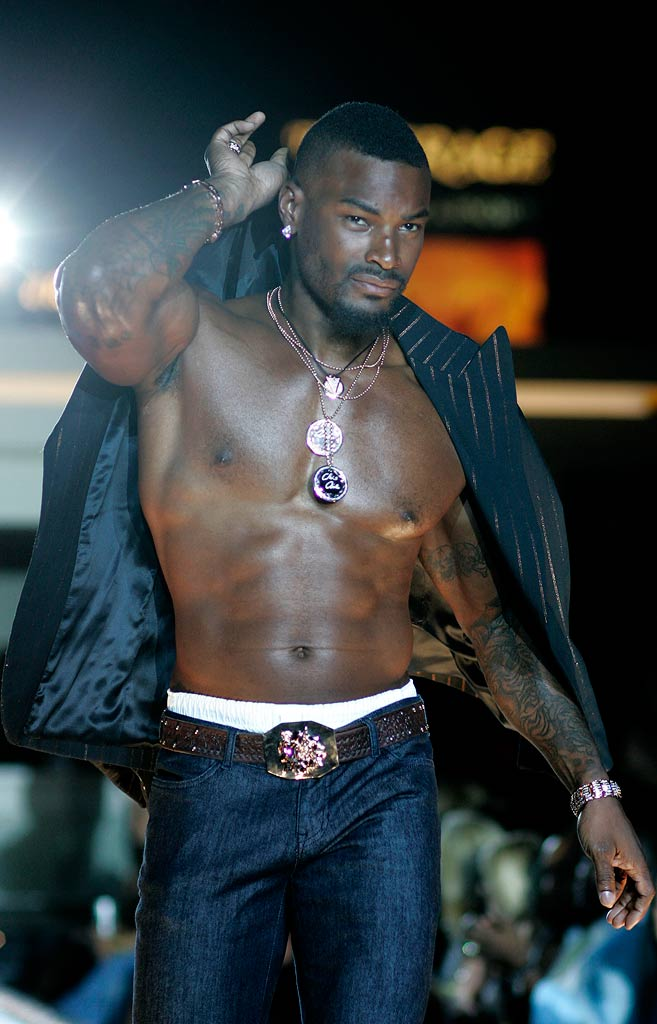 Tyson Beckford wearing Chris Aire at the Chris Aire Fashion Show at Pure Nightclub.