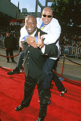 Premiere: Michael Clarke Duncan gives fellow cool guy Ving Rhames a piggy-back ride at The Chinese Theater premiere of Paramount's Mission Impossible 2 - 5/18/2000