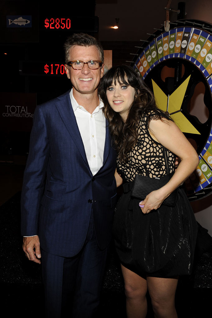 "Kevin Reilly (President of Entertainment, Fox) and Zooey Deschanel of ""New Girl"" at the 2011 Fox Fall Eco-Casino Party at The BookBindery on September 12, 2011 in Culver City, California."