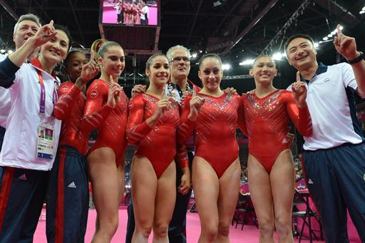Members of the U.S. women's gymnastics team celebrate winning team gold. (AFP)