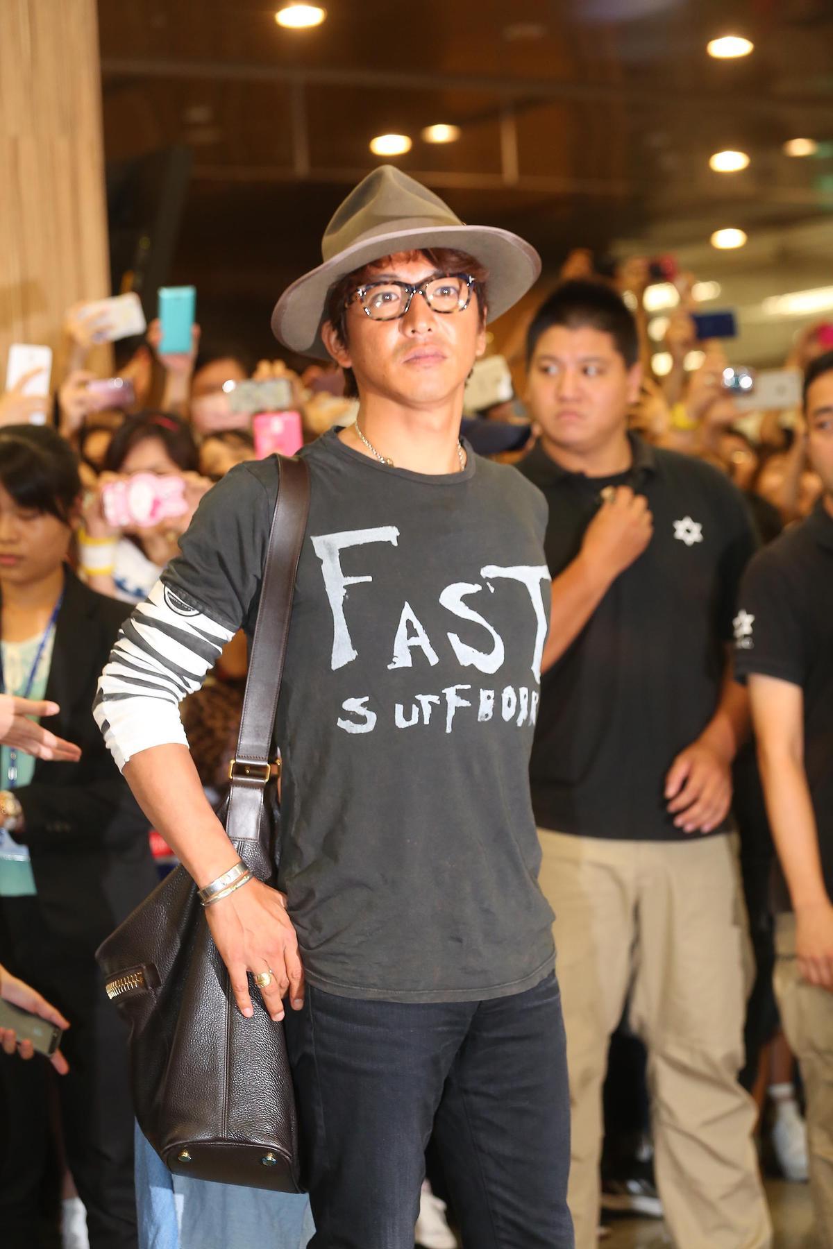 2015年來台時,木村還是個潮人型男,他的機場時尚也引起不少媒體追捧。
