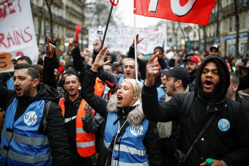 Scuffles break out in Paris as pensions protesters, yellow vests march