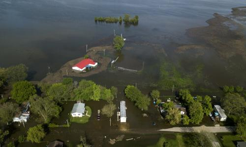 Bigger picture, its climate change: Great Lakes flood ravages homes and roads