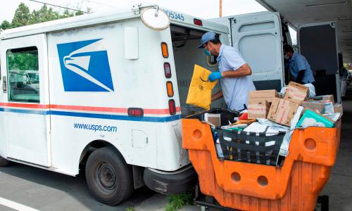 US Postal Service announces cost-saving changes amid vote-by-mail fears