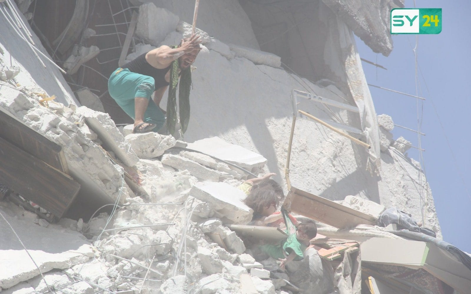 Syrian father scrambles to reach his children after airstrike in Idlib