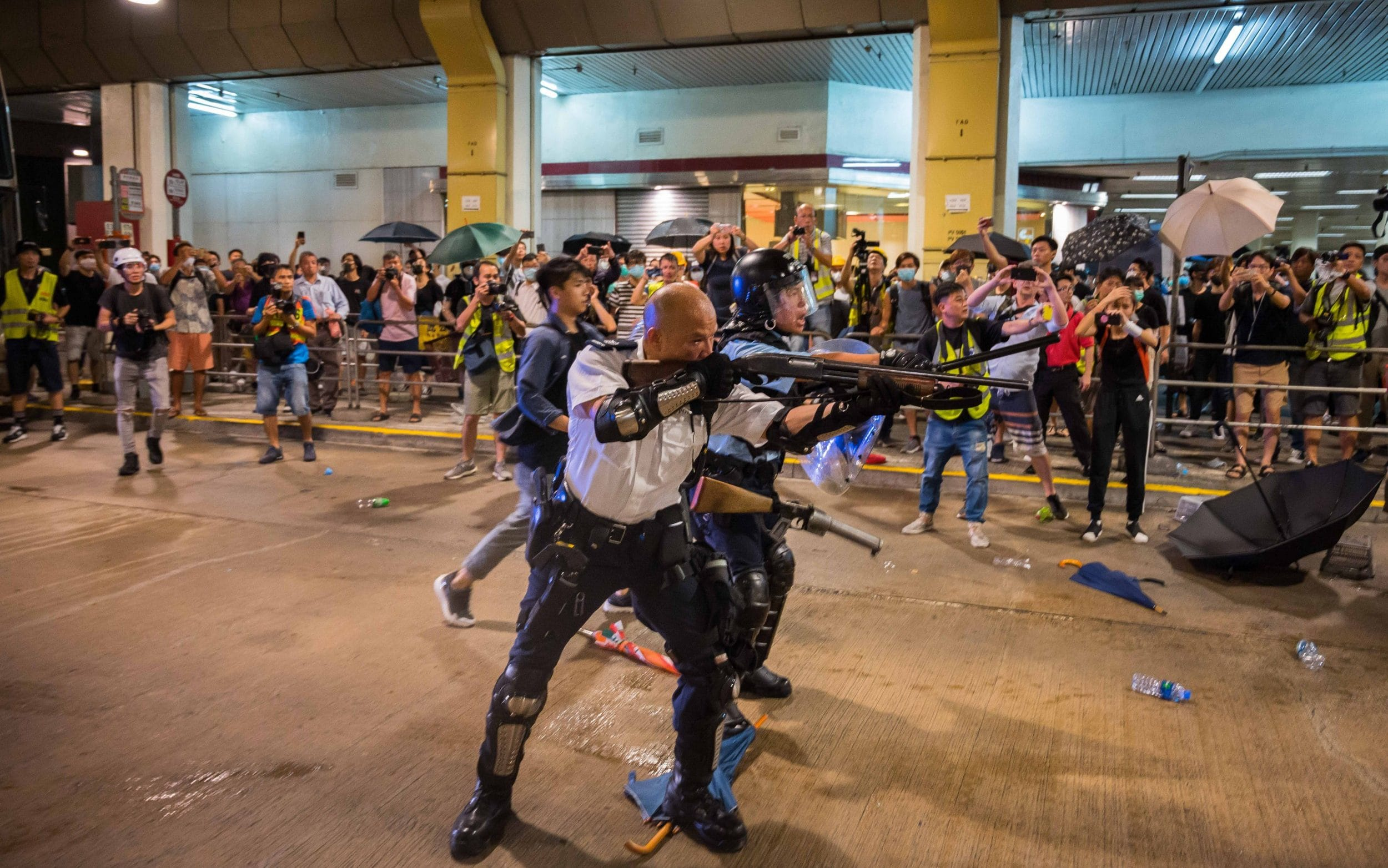 Hong Kong protesters clash with police as 44 activists charged with rioting