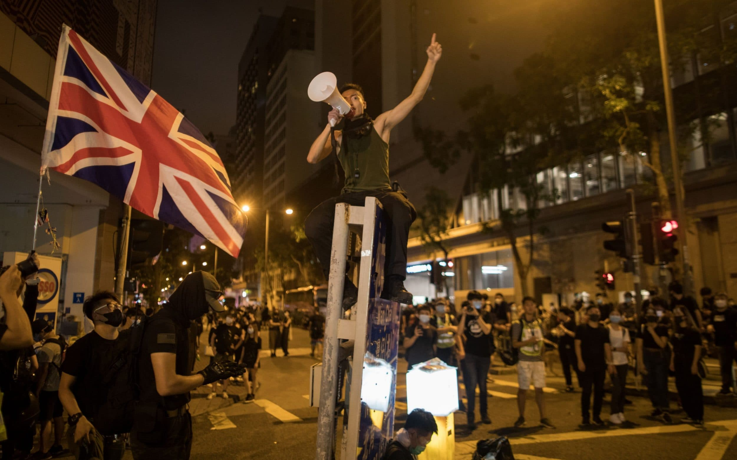Britain warns China to abide by one-country-two-systems rule ahead of anniversary protests
