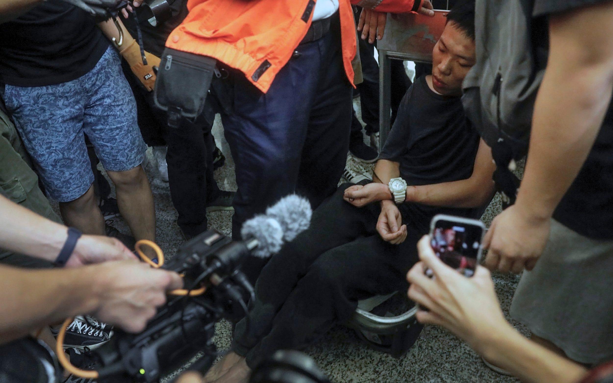 Beijing preparing tanks at Hong Kong border, warns Trump as protesters clash with police at airport