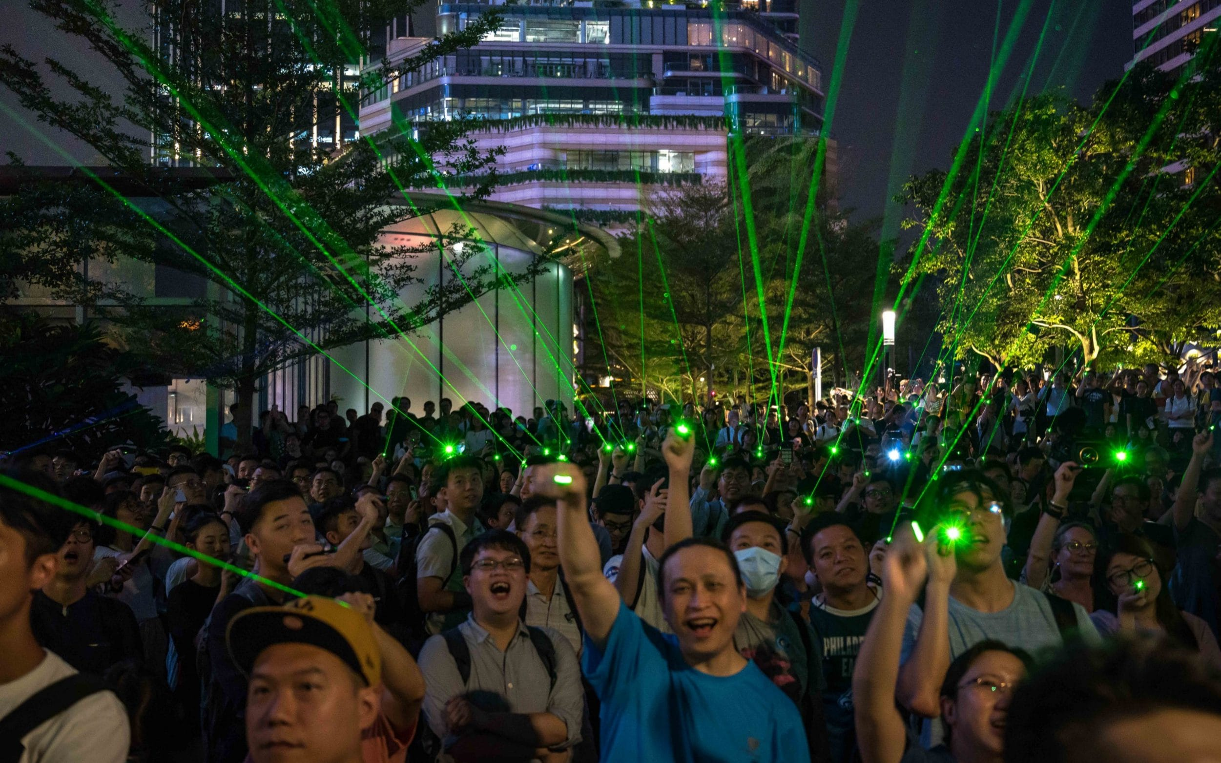 Hong Kong protesters produce laser show over arrest of demonstrator shining pointer at police