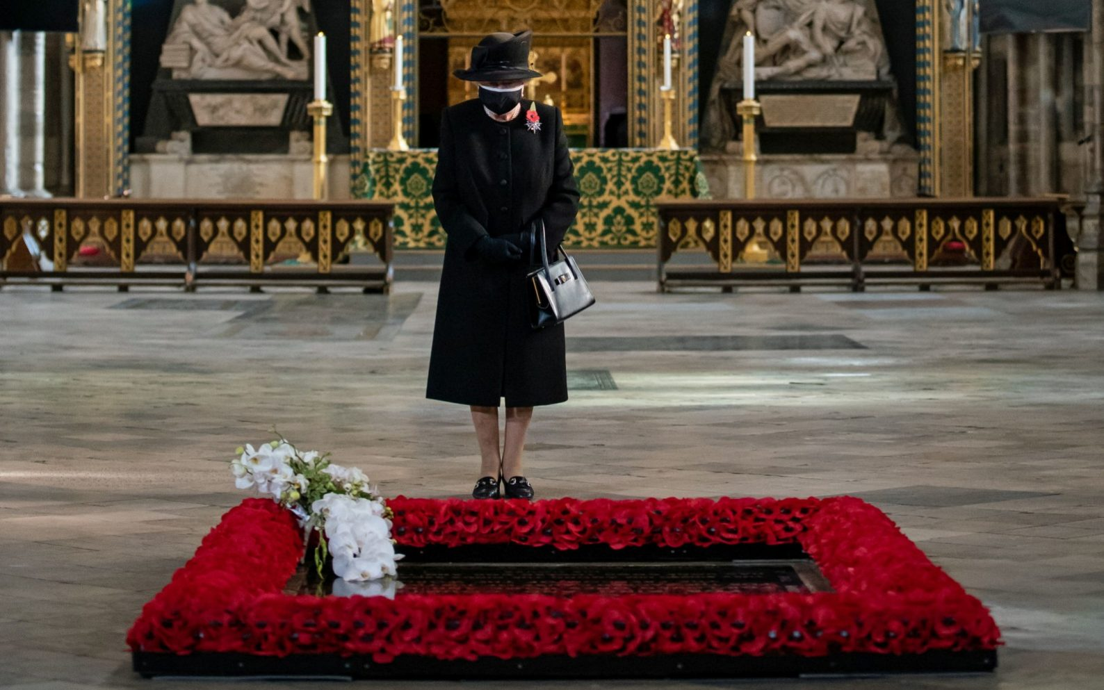 Queen returns to London for private tribute to the fallen