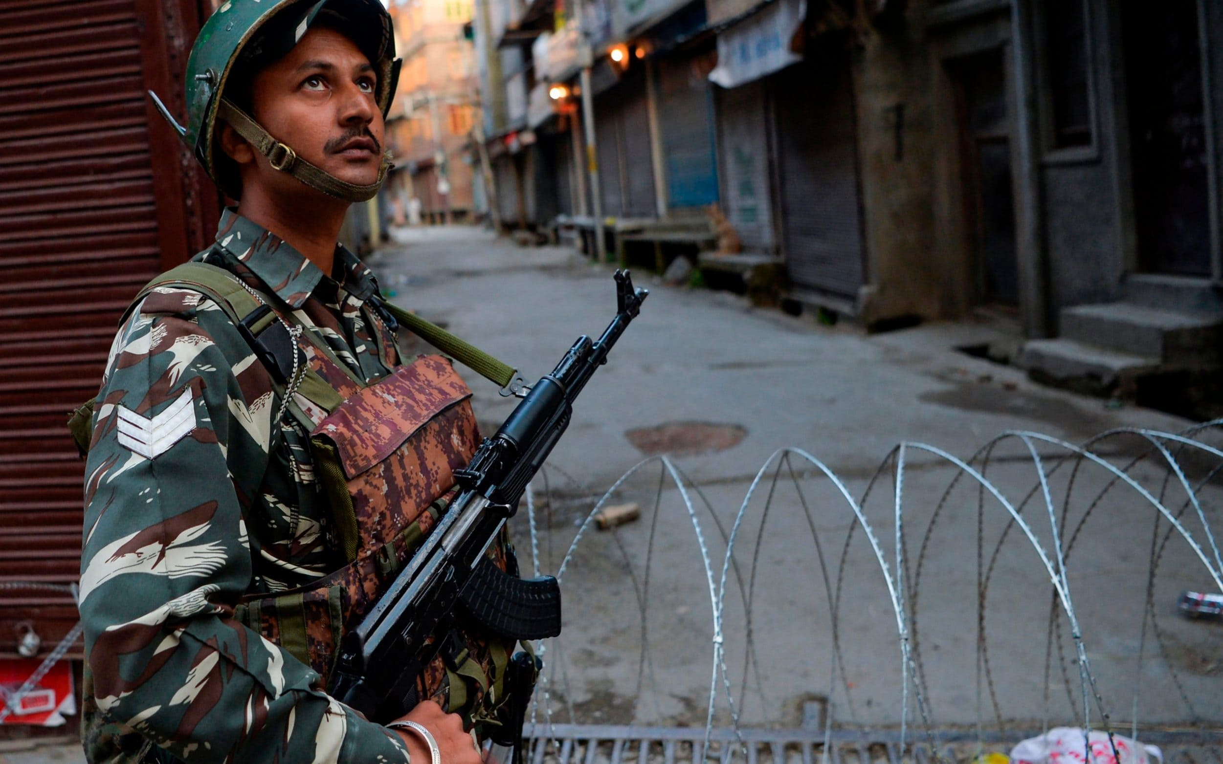 India promises to ease Kashmir curfew as Pakistan accuses New Delhi government of ethnic cleansing