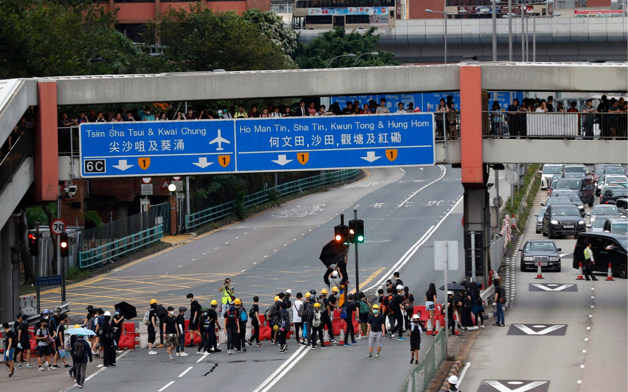 Hong Kong protesters block tunnel as marches continue in defiance of Beijing