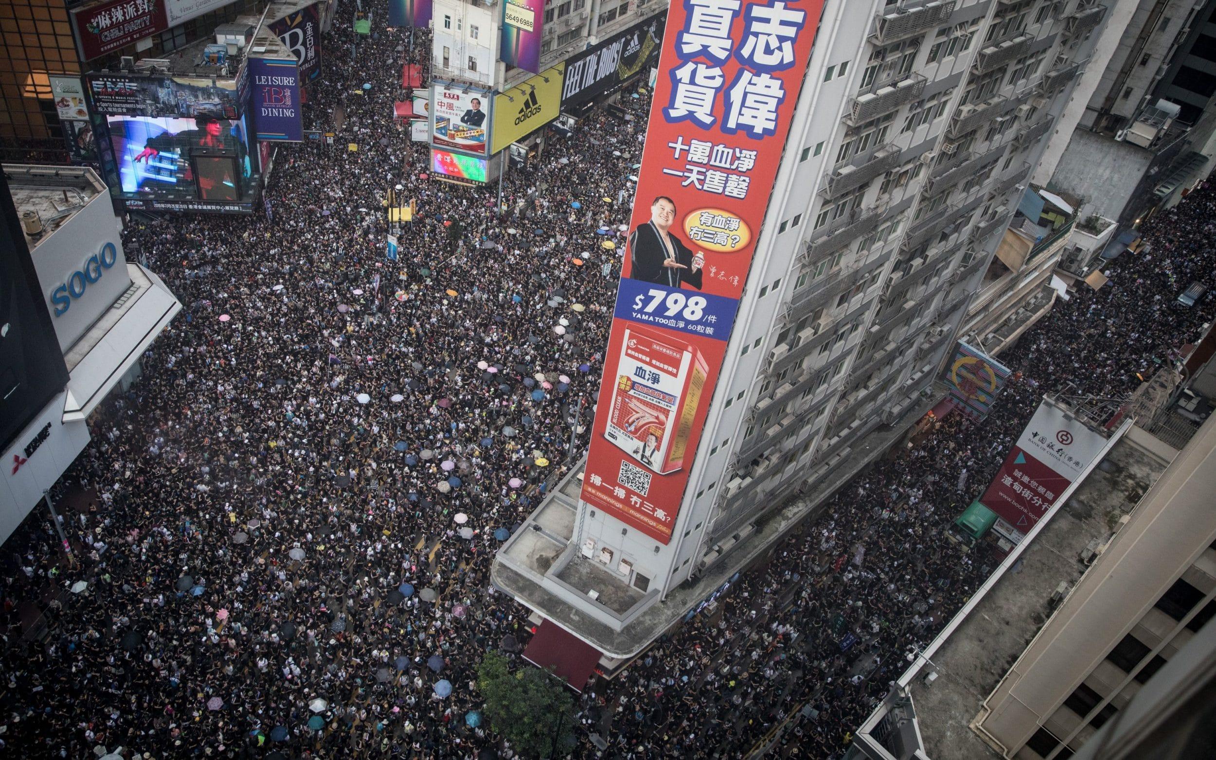 Hong Kong protesters to defy police ban after mob violence