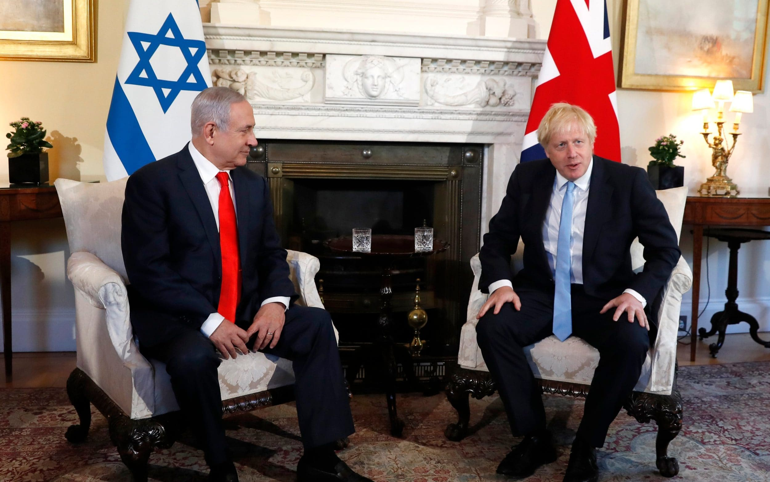 Britain rejects calls to take tougher stance on Iran as Benjamin Netanyahu meets Boris Johnson