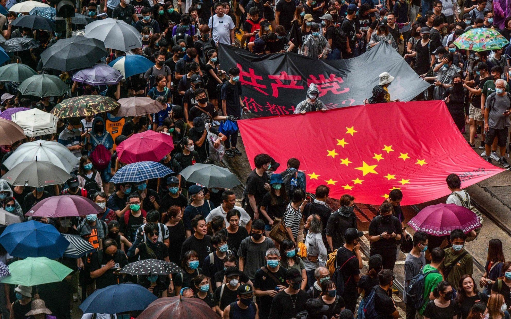 Hong Kong police fire water cannon and tear gas as protesters defy rally ban with petrol bombs