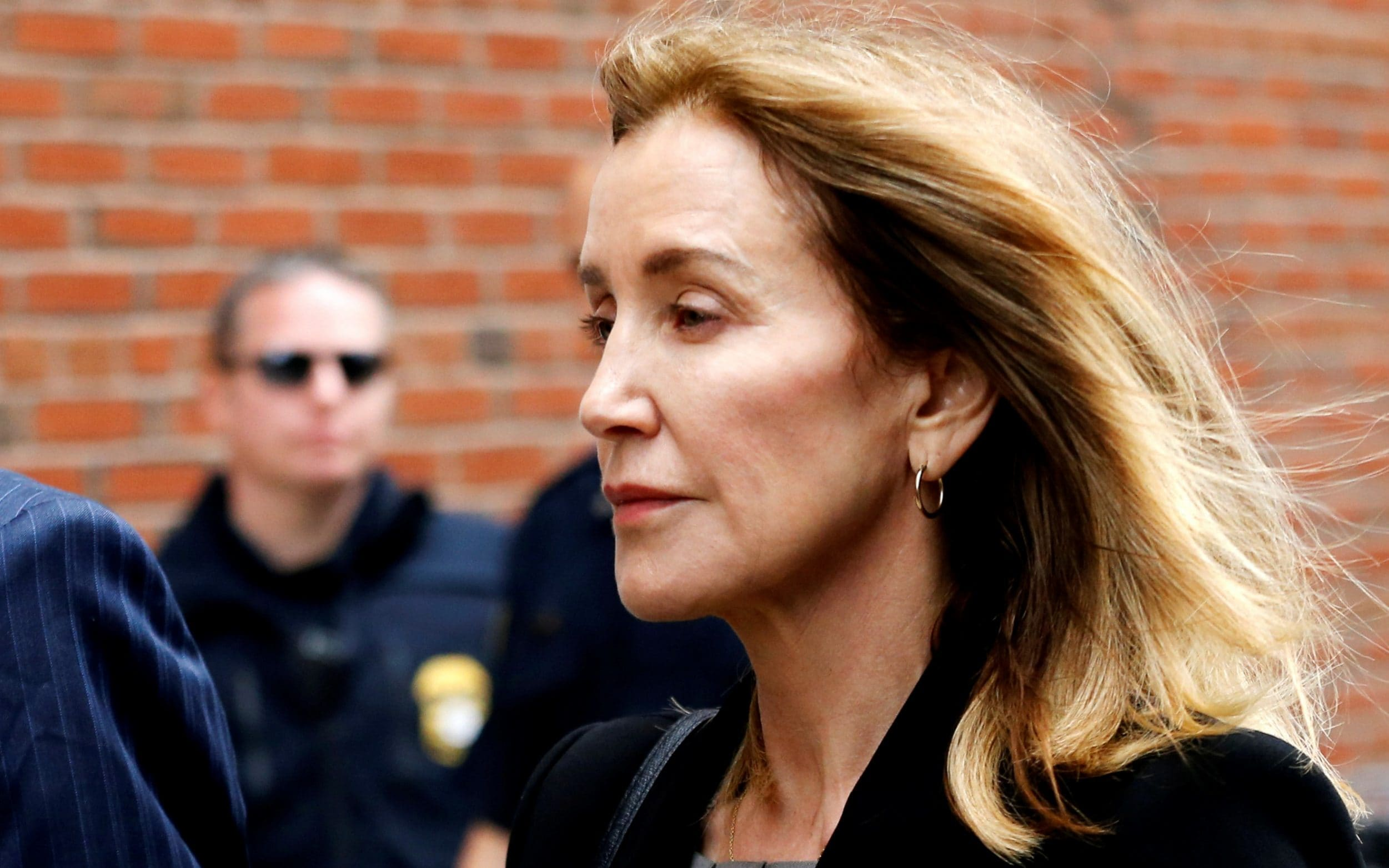 Felicity Huffmans two-week jail sentence triggers claims of white privilege