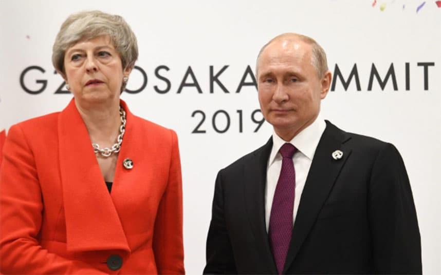 Theresa May calls on Vladimir Putin to halt irresponsible activity around the world