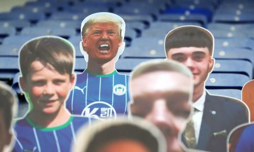 "Wigan v Stoke City - Sky Bet Championship - DW Stadium<br>A cardboard cutout of Donald Trump (top row, left) in the stands before the Sky Bet Championship match at the DW Stadium, Wigan. PA Photo. Issue date: Tuesday June 30, 2020. See PA story SOCCER Wigan. Photo credit should read: Martin Rickett/PA Wire. RESTRICTIONS: EDITORIAL USE ONLY No use with unauthorised audio, video, data, fixture lists, club/league logos or ""live"" services. Online in-match use limited to 120 images, no video emulation. No use in betting, games or single club/league/player publications."
