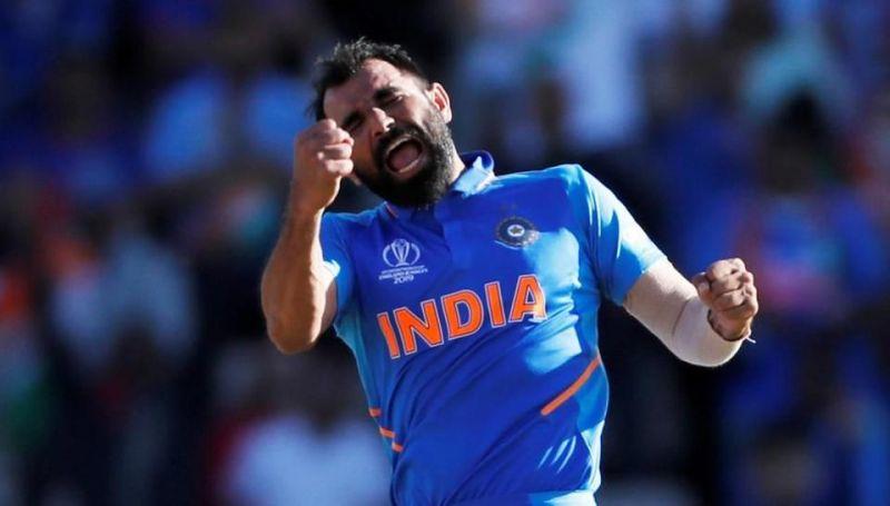 Shami celebrates after picking up his hat-trick against Afghanistan.