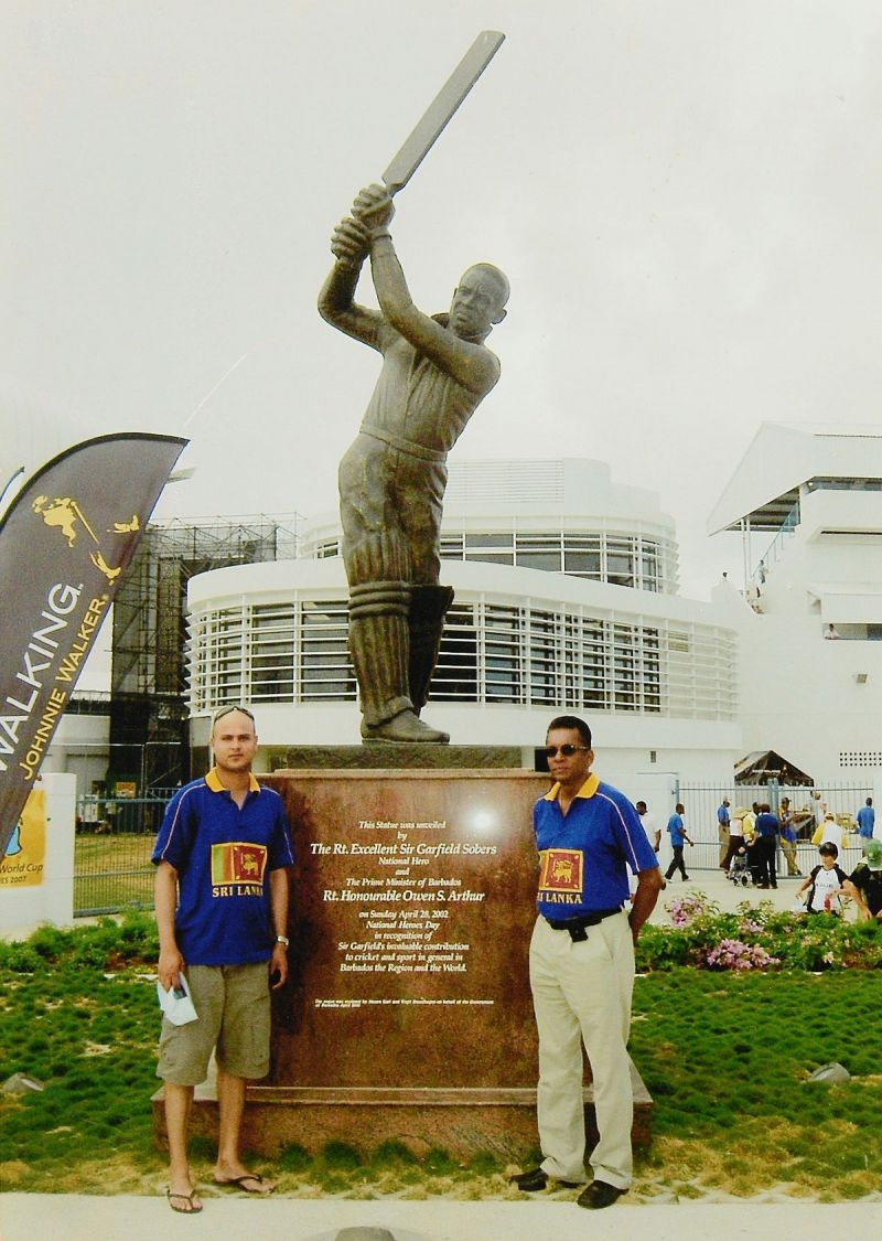 Snap with the greatest: My friend, Adrian (left) and yours truly standing before the statue of Sir Garfield Sobers at the Kensington Oval in Bridgetown, Barbados prior to the start of the 2007 ICC Cricket World Cup final on 28 April 2007. (© Ranjan Mellawa)