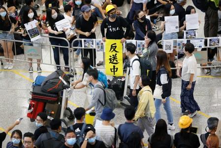 Economic downturn to hit Hong Kong like a tsunami, citys leader warns