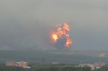 Blasts rock Russian arms depot, eight injured - TASS